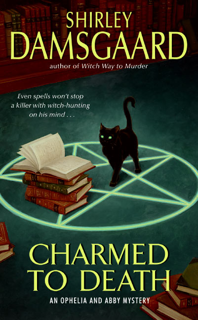 Charmed to Death (Ophelia and Abby Mysteries, #2)
